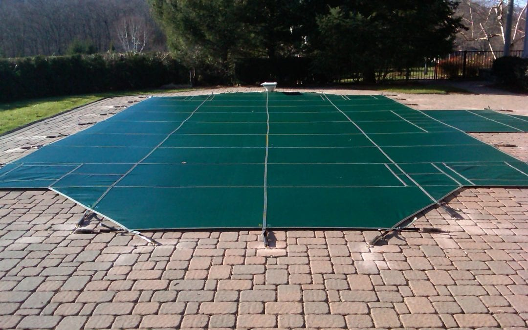 Properly Winterizing Your Swimming Pool: Safety Covers & Freeze ...